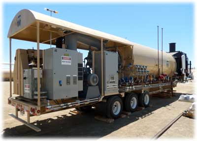 Side view of trailer-mounted steam generator and control systems